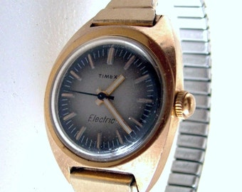 Vintage Ladies 1974 Timex Electric Watch Gold Color With Original Speidel Stainless Band