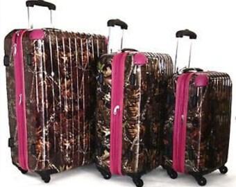 Three piece Hardshell Luggage Set.  Camo Print with Pink Trim.  360 degree wheels