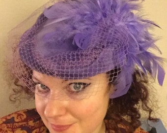 Cute lilac velvet pillbox hat with feathers and veil