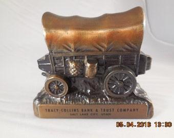 Metal advertising bank, canastoga covered wagon.