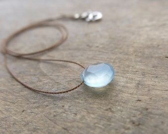 Chalcedony necklace. Aqua blue chalcedony necklace.  Minimalist necklace with a faceted aqua blue chalcedony briolette. Silk thread necklace