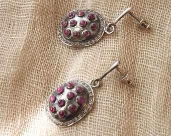Modern Mughal dangle earrings with ruby cabochons and glittery white topaz set in oxidised & palladium plated sterling silver