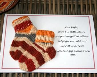 Greeting card for birth, congratulation card, red orange striped socks, 21 x 15cm