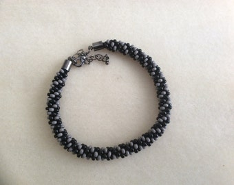 Black and grey beaded kumihimo bracelet