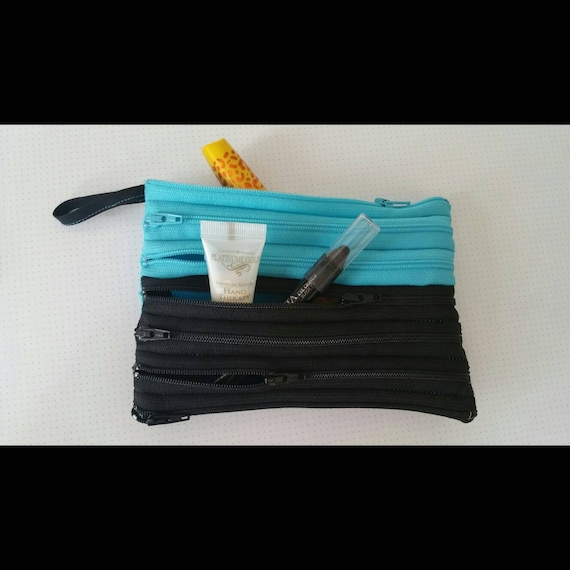Black and Carolina Blue multi zip pouch. Works as wallet, purse, or make up pouch.