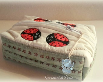 Fabric pouch with embroidered ladybugs