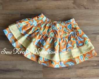 Children's - Orange and Blue Paisely with Orange Plaid 3 Tier Skirt