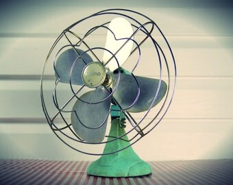 "Vintage 1940s Mint Green ""Eskimo"" Cast iron Oscillating Aluminum Blade Fan by McGraw-Edison Co., in working condition..."