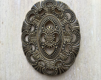 Adorned vintage metal brooch, antique gold colored
