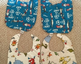 Four baby bibs themed