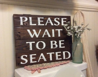 Please Wait To Be Seated Bathroom Sign