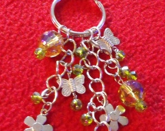 April   CD051.  Danglez Purse Charms.   SIlver with butterfly and flower charms, yellow and green irridescent glass beads. 5.5 inches long.