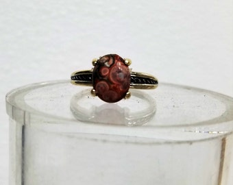 this ring is a  size 7 3/4 the stone is a 8 x 10 mm ocean jasper.  It has a very nice band.