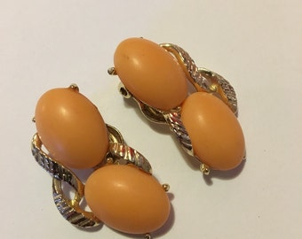 Vintage peach colored clip on earrings gold tone