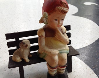 Plastic Hummel Like Figurine of Girl on a Bench with a Dog