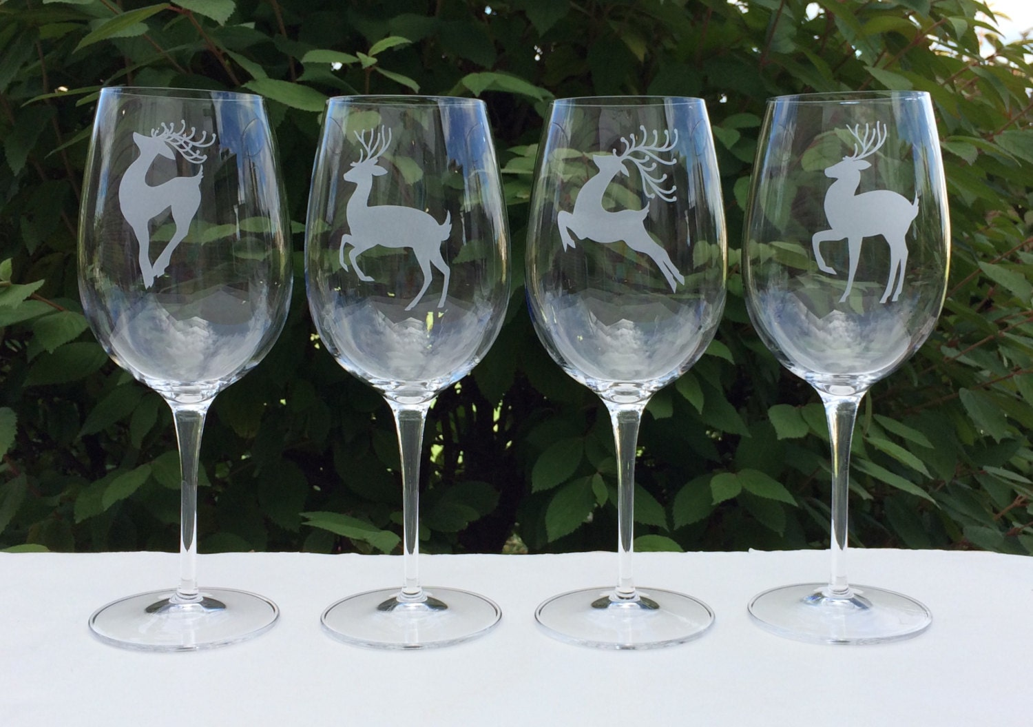 Reindeer wine glasses holiday wine glasses by for Holiday stemware