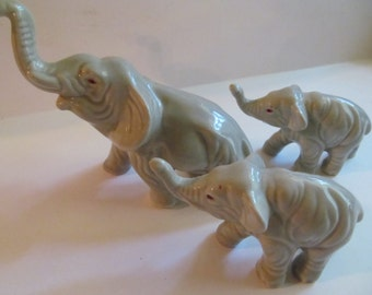 Ceramic grey  Elephant Figurines  set of 3  with truncks up for ''Good Luck''