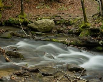 Rocks in a Flowing Stream