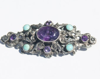 Vintage, sterling silver, brooch, made in Mexico, small turquoise stones and larger sapphire.