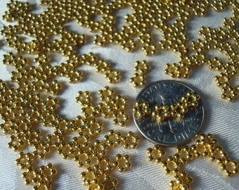 400 New-Gold Daisy Spacers. 4.5mm. Quality Made Daisy Spacer. 1.5mm Thick.  Tiny Five (5) Petal Daisy  ~USPS Standard Ship Rates from Oregon