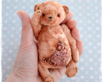 Vintage plush teddy bear with embroidery