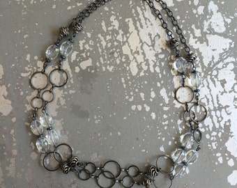 Convertible clear glass and gunmetal necklace.