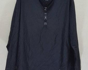 Vintage Nike winbreaker jacket jogging halfzipper