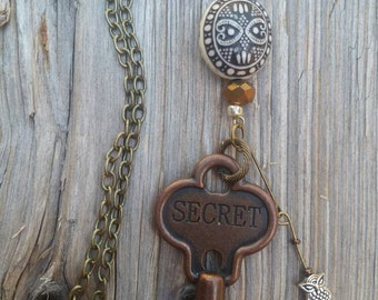 Metal key secret  with owl charm.