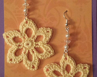 Yellow flower earrings with pearl and crystal beads.