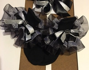 Girls black and silver ruffle socks with matching bows