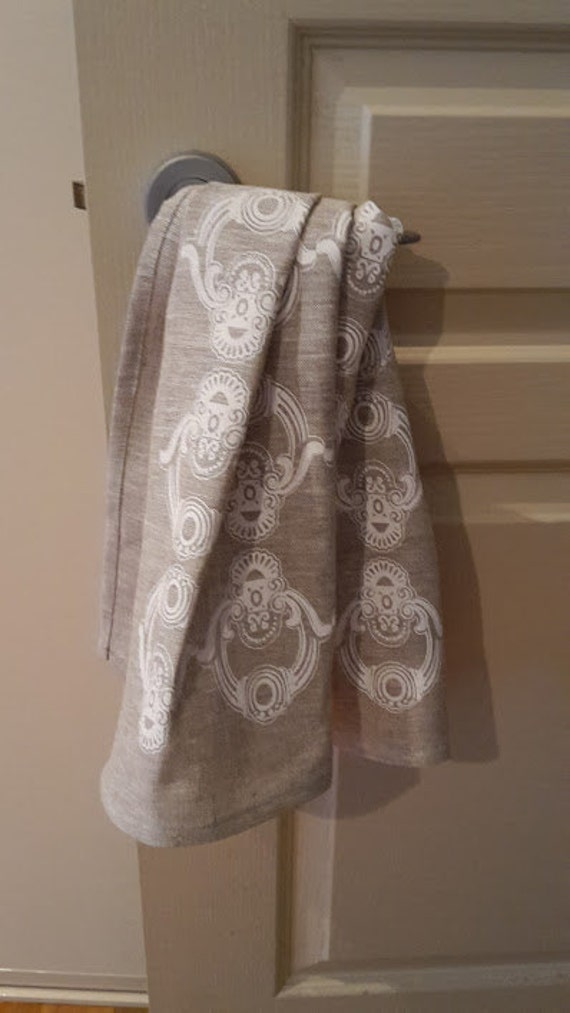 Hand printed linen tea towel in white on oatmeal. Lovely neutrals to coordinate with contemporary living spaces.