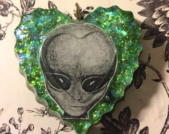 Green alien pendant necklace