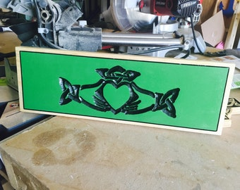 Claddagh represents love, loyalty, and friendship carved into this sign in a lovely green color