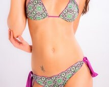 Conxita No.375 Geometric print in mosaic style in greens and brown on white background. Top straps, tie sides and trim in lilac.