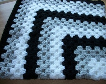 Hand crocheted baby blanket. Pale grey, white and black. Suitable for car seat, crib, pram or moses basket. Ideal just to wrap baby in.