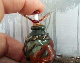 Little Red Riding Hood inspired blown glass potion bottle .The .'Wolf.' in the Forrest...with tiny leaf and toadstool on the cork stopper.