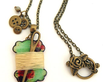 Seamstress pendant, with needle and buttons