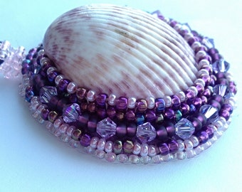 Pendant purple from shells, beads and Swarovski crystals