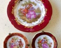 Limoges Vintage Miniature Plates in Burgandy. Porcelain. Fragonard Design. Courting Couple. Measure 4cms and 8cms in diameter.  Meissner.