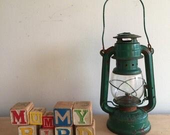 Green made in China hurricane lamp