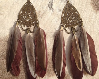 Ornate feather earrings