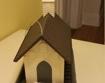 White church birdfeeder