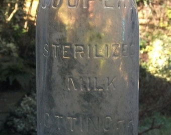 Vintage Milk Bottle! 'Cooper's Sterilized Milk Nottingham'. Vintage Nottingham bottle. 1930s 1940s large glass bottle. Embossed bottle.
