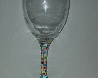 Hand painted multicolour spot wine glass.