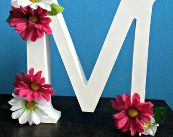Letter. Decorative letter with fake flowers.