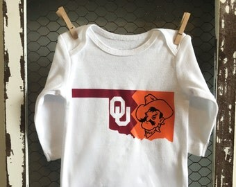 University of Oklahoma Sooners vs Oklahoma State University Cowboys Baby Divided / House Divided Onesie | Perfect for football season!