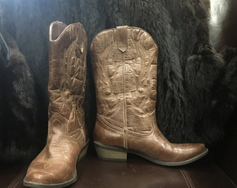 Rewind 104:  Brown Leather Cowboy Boots. Calf length. 1 inch heel. Gently loved. Size 6.