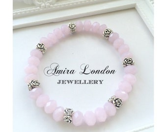 Opal pink faceted crystal beaded bracelet with silver tone rose flower spacers.