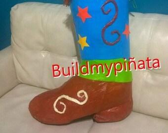 "Cowboy boot piñata, 3D, 26"" tall."