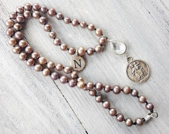 Knotted pearls necklace with coin pendant. Necklace with crystal and letter charm